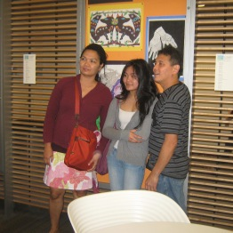 A student with her family at the SRB exhibition.