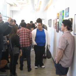 Students and families viewing their exhibit at the Museum Office.